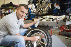 Mechanic Working On A Tire Stock Image