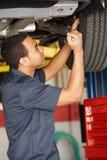 Mechanic working under car Royalty Free Stock Photos