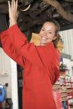Mechanic working under car royalty free stock photo