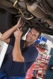 Mechanic working under car stock photo