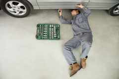 Mechanic Working on Underside of Car Royalty Free Stock Photos