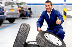 Mechanic working on wheels Royalty Free Stock Photography