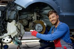 Mechanic in a workshop. Mechanic checking car brake system in a workshop Royalty Free Stock Photos