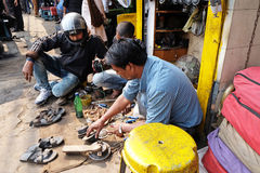 Mechanic at workshop on Malik Bazaar in Kolkata. India Stock Photo