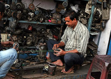 Mechanic at workshop on Malik Bazaar in Kolkata. India Royalty Free Stock Images