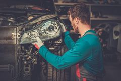 Mechanic in a workshop Stock Images