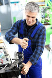 Mechanic in the workshop Royalty Free Stock Image