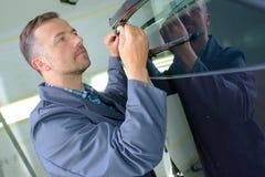 Mechanic worling on panel stock photo