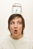 Mechanical alarm clock  stand on head funny white man Royalty Free Stock Images