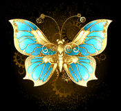 Mechanical Butterfly. Brass and gold with wings decorated with blue glass and gears Stock Photography