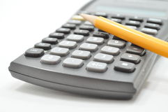 Mechanical Calculating. Mechanical Pencil rested against scientific calculator stock images