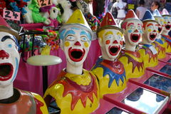 Mechanical circus clown faces Stock Images