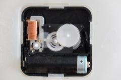 Mechanical clock gears. Inside the mechanical clock gears inside the plastic of the watch stock photo