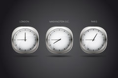 Mechanical clocks displaying time in three big cit Royalty Free Stock Photos