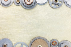 Mechanical cogwheels on scratched brass industrial background Stock Photography
