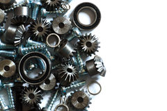 Mechanical components. A background with different mechanical components, gears, springs, screws, industrial objects Stock Images