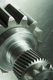 Mechanical concept. Gears and axels on aluminum Royalty Free Stock Images