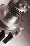 Mechanical concept. Cog, gears and axel on aluminum Royalty Free Stock Image
