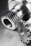 Mechanical concept in black/white. Gears and axel against brushed aluminum Stock Image