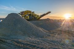 Mechanical conveyor belt to pulverize rock and stone and generate gravel. In Spain royalty free stock image