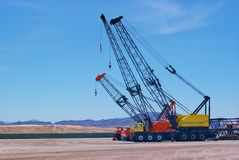 Mechanical Cranes in the desert Royalty Free Stock Photo