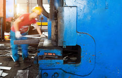 Mechanical cutting machine. Cutting machine for metal sheets in mechanical workshop Royalty Free Stock Image