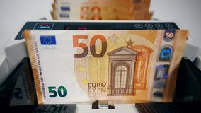 Mechanical device is counting euro banknotes. 4K stock footage