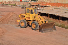 A Mechanical Digger - Bulldozer JCB CAT Construction Plant Machinery. A bulldozer complete with large bucket stock images