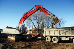 Mechanical digger and truck Stock Images