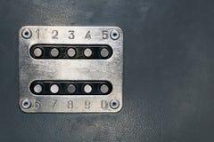 Mechanical door lock controll. Rough mechanical door lock control pad with numbers Stock Image