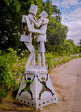 Mechanical Embrace. A robot couple, constructed from scrap metal and pipes, are seen in a loving embrace Royalty Free Stock Photo