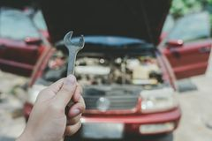 Mechanical engineer hands open the car skirt to check the oil level of the car. The concept of engine maintenance Travel safely. Caring for old cars royalty free stock photos