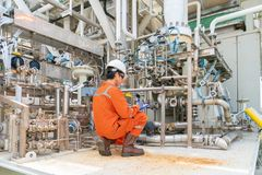 Mechanical engineer inspector inspection crude oil pump centrifugal type at offshore oil and gas central processing platform. stock photo