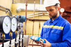 Mechanical engineer measuring values of pressure on manometers stock photo