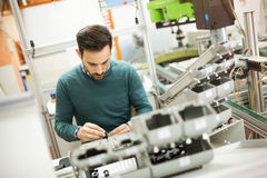 Mechanical engineer working on machines. Creative mechanical engineer working on machines stock photography