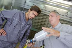 Mechanical engineering apprentice and teacher. Mechanical engineering apprentice and his teacher royalty free stock photo