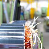 Mechanical engineering: closeup of electric motors in production. In a modern factory stock image