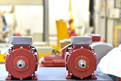 Mechanical engineering: closeup of electric motors in production. In a modern factory royalty free stock photo