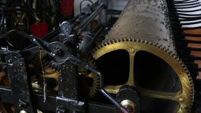An mechanical engineering concept image consisting of an antique bell tower clock machine. stock footage