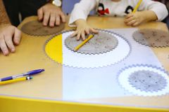 Mechanical engineering education for children. Little kid study basics of mechanical engineering stock photography