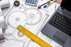Mechanical engineering of parts with tools, laptop. Drawing top royalty free stock photo