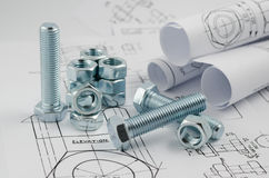 Mechanical Engineering Technology. Nuts and bolts on paper drawings Stock Image