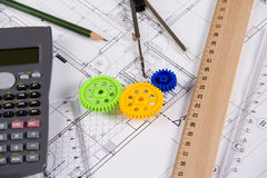 Mechanical Engineering. Engineering tools and colorful gears on blueprints Royalty Free Stock Image