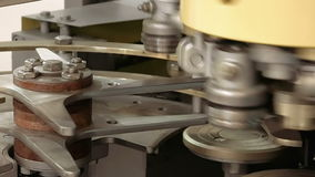 Mechanical equipment for bottling. Bottling and sealing mechanical machine equipment with rotating parts. Automated robotic line at factory or plant stock video