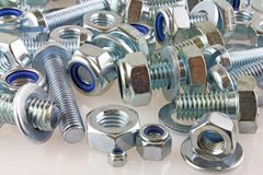 Mechanical fastener. A view of nut, bolts and washers stock photo