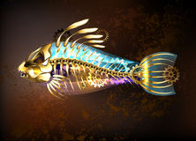 Mechanical fish. Mechanical, antique gold fish with skeleton and gears on a brown background. Steampunk style Stock Photography