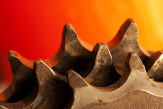 Mechanical gear teeth. Closeup of a series of mechanical gear teeth, possibly on a bicycle sprocket stock images
