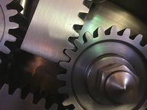 Mechanical Gears. Metal mechanical gears reveal the inner workings of a bank safe Stock Image