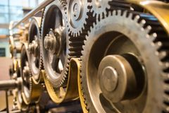 Mechanical gears wheels closeup view. Huge mechanical gears wheels at printery closeup view Stock Images