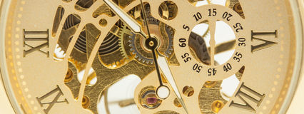 Mechanical gold watch macro Stock Image